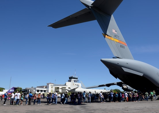 Citizens from El Salvador, line up to enter a U.S. Air Force C-17 Globemaster III cargo aircraft, 58th Airlift Squadron, at Ilopango International Airport in San Salvador, El Savador, Jan. 30, during the 2016 Ilopango Airshow. The C-17 was sent from Altus Air Force Base, Okla., to foster relationships between the U.S. and El Salvador. The aircraft was setup as a static display for the attendees to view and learn about some of its capabilities. (U.S. Air Force photo by Senior Airman Franklin R. Ramos/Released)