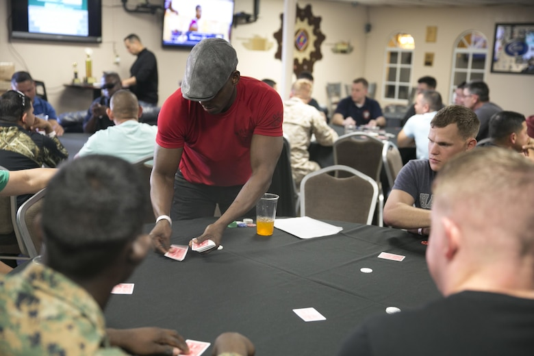 Sgt. Maj. Brain Priester, sergeant major, 1st Tank Battalion, deals a hand of cards during the Hashmarks Staff Non-Commissioned Officer Club Texas Hold'em Poker Tournament, Jan. 30, 2016. (Official Marine Corps photo by Cpl. Thomas Mudd/Released)