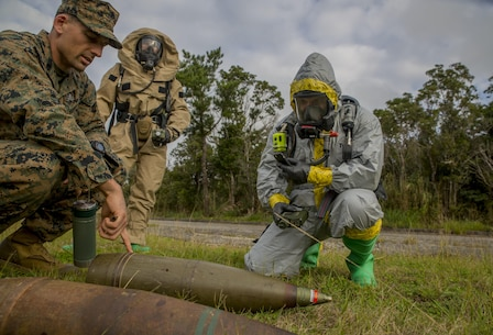 Staff Sgt. Jarret Garibaldi, left, instructs Staff Sgt. Cody Fazio on a 155 mm howitzer round during a joint-training exercise between III Marine Expeditionary Force Chemical, Biological, Radiological, Nuclear and Explosive Ordnance Disposal units at the Central Training Area, Camp Hansen, Okinawa, Japan, Jan. 29, 2016. The exercise enhances unit cohesion between the two units for further training, real-world instances and keeping the Asia-Pacific region safe from explosive ordnance and CBRN threats. Garibaldi is from Napa, California, and is an EOD technician with 3rd Ordnance Disposal Company, 9th Engineer Support Battalion, 3rd Marine Logistics Group, III MEF. Fazio, from Billings, Montana, is an EOD technician with 3rd Ordnance Disposal Company, 9th ESB, 3rd MLG, III MEF. (U.S. Marine Corps photo by Lance Cpl. Kelsey M. Dornfeld/ Released)