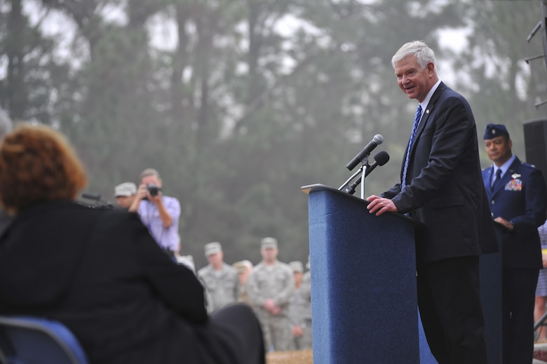 Retired Gen. Charles Holland, former commander of U.S. Special Operations Command and Air Force Special Operations Command, speaks during an AC-130H Spectre dedication ceremony February 2, 2016, at Hurlburt Field, Fl. More than 400 people attended the dedication ceremonies for the AC-130H Spectre and MC-130P Combat Shadow to honor the legacy of these aircraft at the air park. As the aircraft retire, the Air Force and Air Force Special Operations Command modernize the fleet with the AC-130J Ghostrider and MC-130J Commando II. (U.S. Air Force photo by Airman 1st Class Joseph Pick)