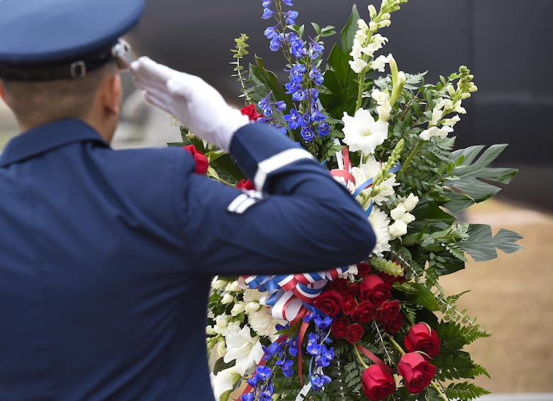 A Hurlburt Field Base Honor Guard member renders a salute during a remembrance ceremony for Spirit 03 at Hurlburt Field, Fla., Feb. 2, 2016. Two days after the 25th anniversary, Air Commandos, friends and families gathered at the Air Park to honor the crew of the AC-130H Spectre gunship, shot down on the morning of Jan. 31, 1991, during the Battle of Khafji. (U.S. Air Force photo by Airman 1st Class Kai White)