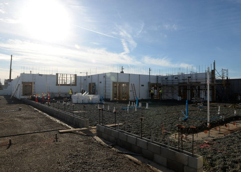 The 9th Civil Engineer Squadron's Administration and Operations Facility is in the progress of construction on Jan. 27, 2016, at Beale Air Force Base, California. The contractors are erecting walls using insulated concrete forms designed to be energy efficient.  The facility is a replacement of the last, which was lost in a fire in January 2013. (U.S. Air Force photo by Senior Airman Ramon A. Adelan)