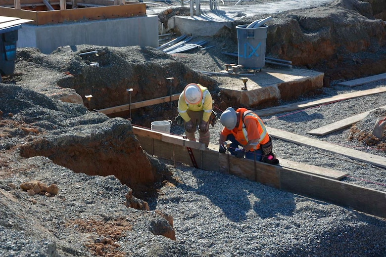 Construction workers layout concrete forms at the 548th Intelligence, Surveillance, and Reconnaissance Group's Distribution Common Ground System project site Jan. 27, 2016, at Beale Air Force Base, California. The DCGS will work in conjunction with other ISR assets to meet the demand for time-critical processing, exploitation, and dissemination of actionable intelligence data in support of combat operations, as well as the ability to support contingencies worldwide and integrate new ISR technologies as they are operationally fielded. (U.S. Air Force photo by Sean Beermann)