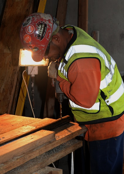 A construction worker drills into a pipe during the building of the 9th Civil Engineer Squadron's Administration and Operations Facility Jan. 27, 2016, at Beale Air Force Base, California. Construction began on the structure April 2015 and is slated to be complete by the summer of 2016. The facility is a replacement of the last, which was lost in a fire in January 2013. (U.S. Air Force photo by Senior Airman Ramon A. Adelan)