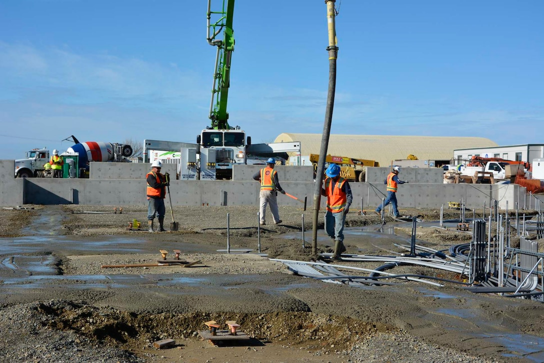 A construction crew pours concrete at the 548th Intelligence, Surveillance, and Reconnaissance Group's Distribution Common Ground System project site Jan. 8, 2016, at Beale Air Force Base, California. The DCGS will work in conjunction with other ISR assets to meet the demand for time-critical processing, exploitation, and dissemination of actionable intelligence data in support of combat operations. They also have the ability to support contingencies worldwide and integrate new ISR technologies as they are operationally fielded. (U.S. Air Force photo by Sean Beermann)