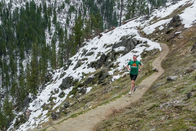 Airman Chester Mientkiewicz, 366th Public Affairs photojournalist, runs along the trail to Skinny Dipper Hot Springs, Idaho, Jan 22, 2016. Idaho's hot springs are often tucked away on the side of a mountain and only require a short hike. (U.S. Air Force photo by Airman 1st Class Connor J. Marth/RELEASED)