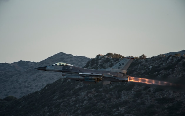 A U.S. Air Force F-16 Fighting Falcon fighter aircraft pilot assigned to the 480th Expeditionary Fighter Squadron takes off from the flightline during a flying training deployment at Souda Bay, Greece, Feb. 1, 2016. The training included more than 15 aircraft launches a day as part of the training between the U.S. and Hellenic air forces. (U.S. Air Force photo by Staff Sgt. Christopher Ruano/Released)