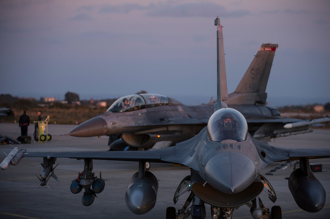 U.S. Air Force pilots from the 480th Expeditionary Fighter Squadron taxi F-16 Fighting Falcon fighter aircraft down the runway during a flying training deployment at Souda Bay, Greece, Feb. 1, 2016. The training took place on the northwest bay of Crete, alongside the island's White Mountain range and over the Mediterranean Sea. (U.S. Air Force photo by Staff Sgt. Christopher Ruano/Released)