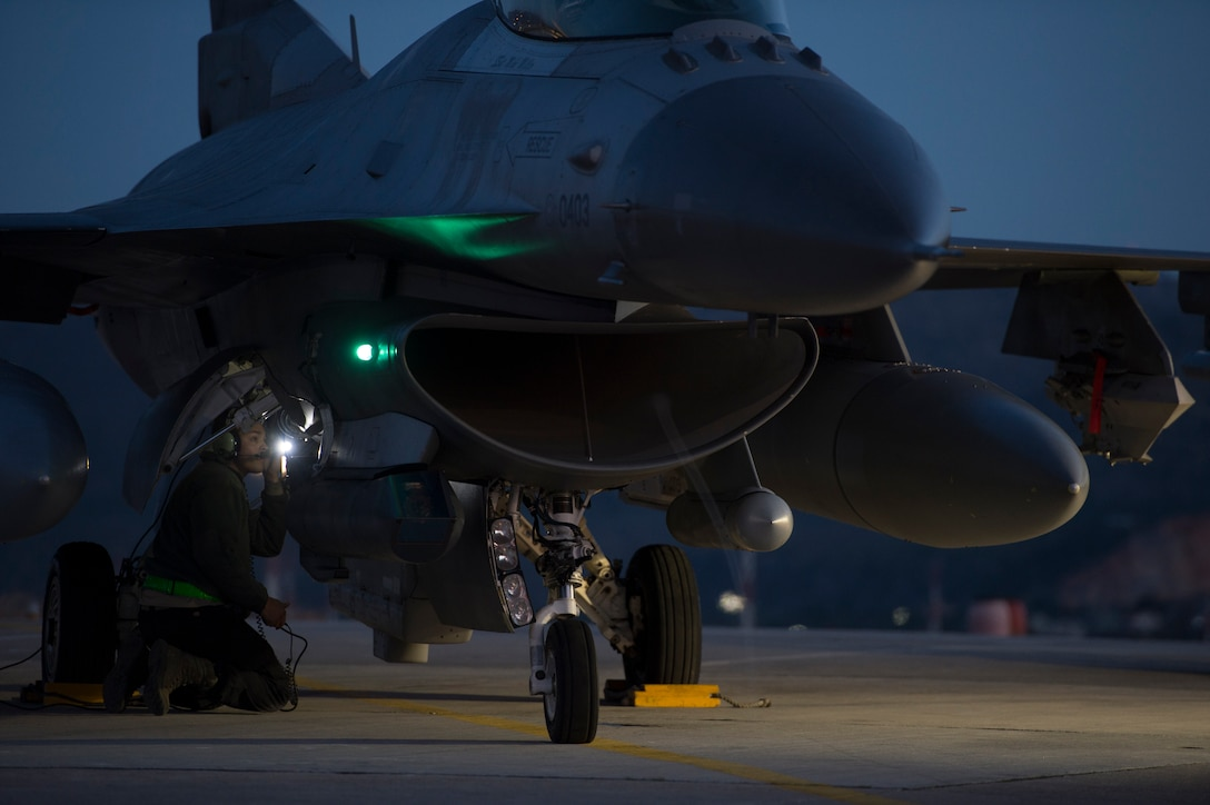 A U.S. Air Force crew chief assigned to the 480th Expeditionary Fighter Squadron performs pre-flight checks on an F-16 Fighting Falcon fighter aircraft before departure during a flying training deployment at Souda Bay, Greece, Feb. 1. 2016. Approximately 300 personnel and 18 F-16s from the 52nd Fighter Wing at Spangdahlem Air Base, Germany, will support the FTD as part of U.S. Air Forces in Europe-Air Forces Africa's Forward Ready Now stance. (U.S. Air Force photo by Staff Sgt. Christopher Ruano/Released)