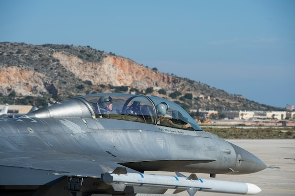 A U.S. Air Force F-16 Fighting Falcon fighter aircraft pilot assigned to the 480th Expeditionary Fighter Squadron carrying U.S. Air Forces in Europe and Air Forces Africa commander Gen. Frank Gorenc, taxi down the flightline during a training mission at Souda Bay, Greece, Feb. 1. 2016.  Gorenc took to the skies with the 480th EFS to experience firsthand the flying training deployment being conducted with the Hellenic air forces. (U.S. Air Force photo by Staff Sgt. Christopher Ruano/Released)