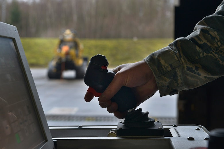 A technician from the 786th Civil Engineer Squadron Explosive Ordnance Disposal prepares the All-purpose Remote Transport System to begin testing Jan. 28, 2016, at Ramstein Air Base, Germany. The ARTS was tested on how it would perform in locating and picking up explosive hazards while keeping the Airmen controlling it safe at a distance. (U.S. Air Force photo/Airman 1st Class Lane T. Plummer)