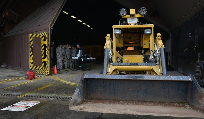 Airmen from the 786th Civil Engineer Squadron Explosive Ordnance Disposal configure their remote computer as they prepare to do maintenance on their All-purpose Remote Transport System Jan. 28, 2016, at Ramstein Air Base, Germany. The Airmen tested the ARTS on maneuvering through an environment and locating objects scattered around the training area. (U.S. Air force photo/Airman 1st Class Lane T. Plummer)