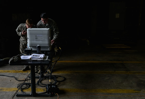Senior Airman Jeffrey Knelange and Airman 1st Class Kevin Leyden, both 786th Civil Engineer Squadron Explosive Ordnance Disposal technicians, navigate a remote-controlled EOD vehicle Jan. 28, 2016, at Ramstein Air Base, Germany. The vehicle, an All-purpose Remote Transport System, is a 3.5-ton vehicle that is can be used as several different tools such as a forklift or an unexploded ordnance clearance vehicle. (U.S. Air Force photo/Airman 1st Class Lane T. Plummer)