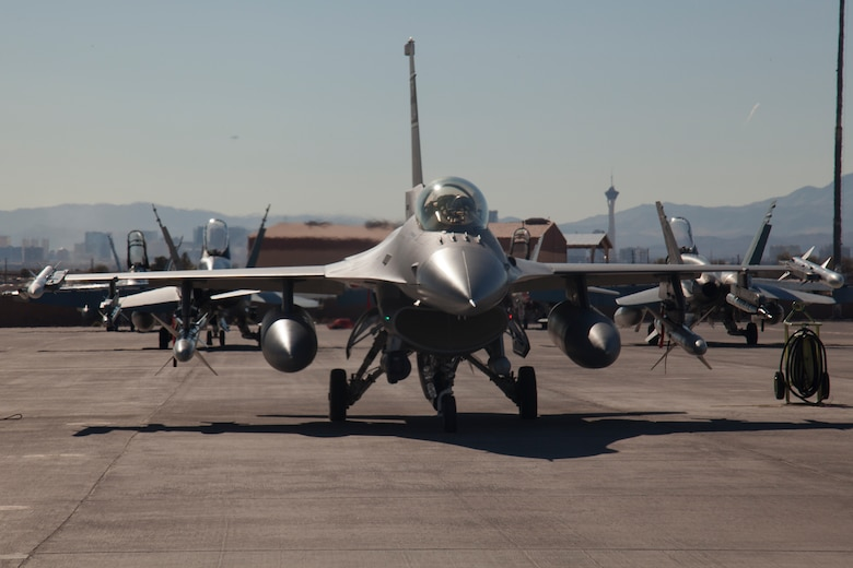 An F-16 Fighting Falcon assigned to the 157th Fighter Squadron, McEntire Joint National Guard Base, S.C., is parked on the Nellis Air Force Base flight line Jan. 26, 2016, during exercise Red Flag 16-1. F-16 Fighting Falcons, along with approximately 30 other airframes, are participating in the advanced training program administered by the United States Warfare Center and executed through the 414th Combat Training Squadron, both located at Nellis Air Force Base. (U.S. Air Force photo by Master Sgt. Burt Traynor/Released)