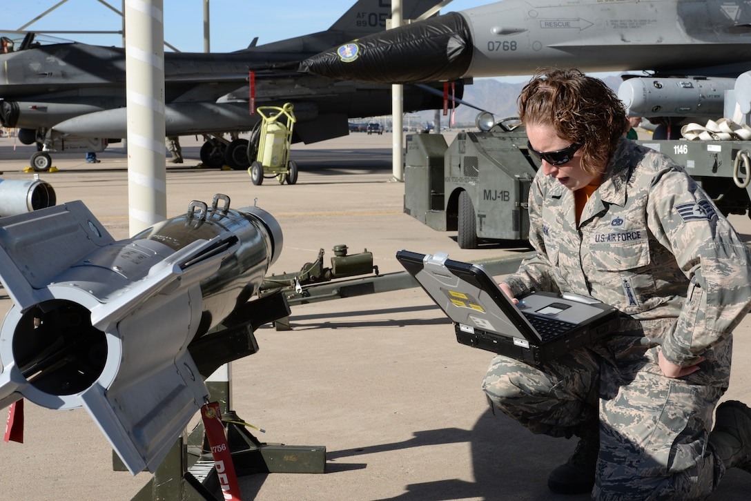 Staff Sgt. Amy Zmak, 61st Aircraft Maintenance Unit load crew member, prepares munitions for loading onto an F-35 Lightning II during the annual competition.