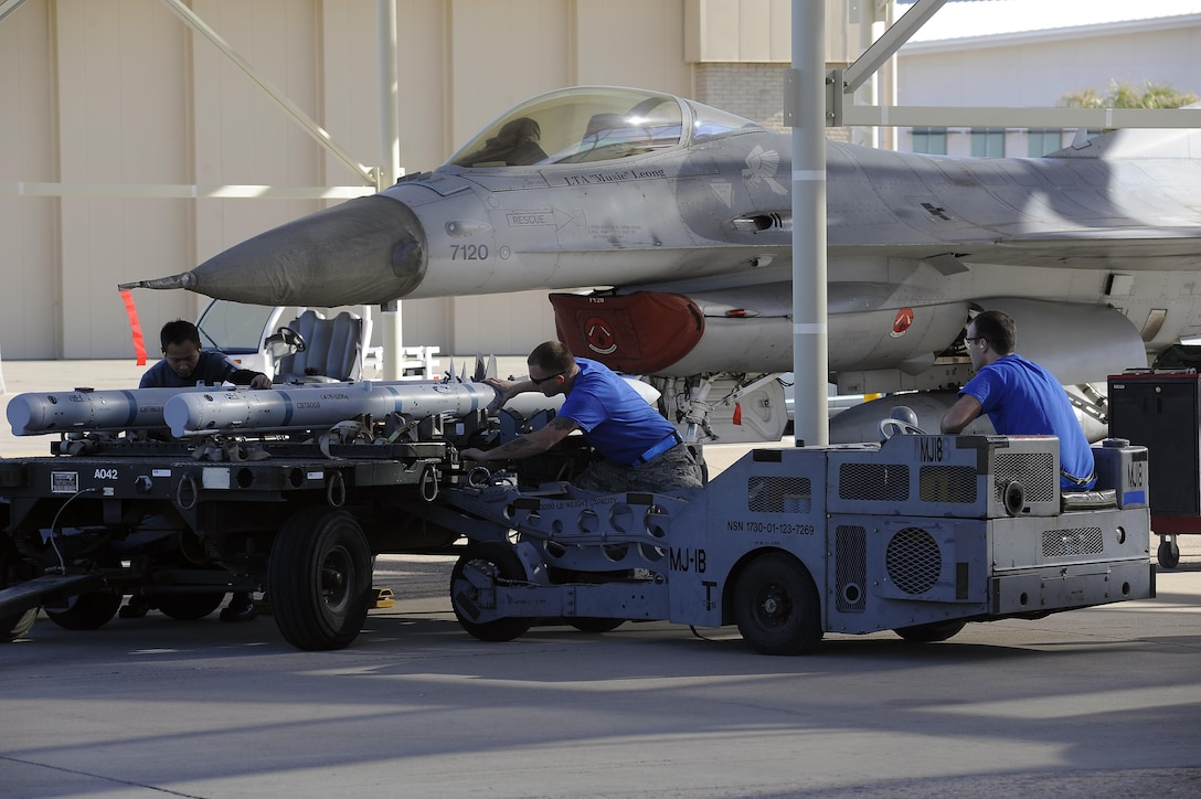The 309th Aircraft Maintenance Unit load crew load their next weapon Jan. 29, 2016 at Luke Air Force Base, Ariz. Teams compete, under the scrutiny of experienced judges, to complete the loading of several weapons on their aircraft within a 35-minute time limit.