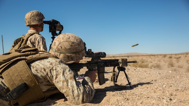 Pfc. Nathan Murdock, rifleman, 3rd Battalion, 7th Marine Regiment, fires his M27 Infantry Automatic Rifle at a target during the Designated Marksman Course's culminating event at Range 113, Jan. 28, 2016.