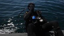 Captain Scott Williams, company commander of Company A, 1st Reconnaissance Battalion, 1st Marine Division, dives out of a rigid-hulled inflatable boat to conduct underwater search operations training off the coast of California, Jan. 28, 2016. The Marines and Sailors of Co. A will use their dive ability to give the 11th Marine Expeditionary Unit a valuable underwater search tool when it deploys later this year.