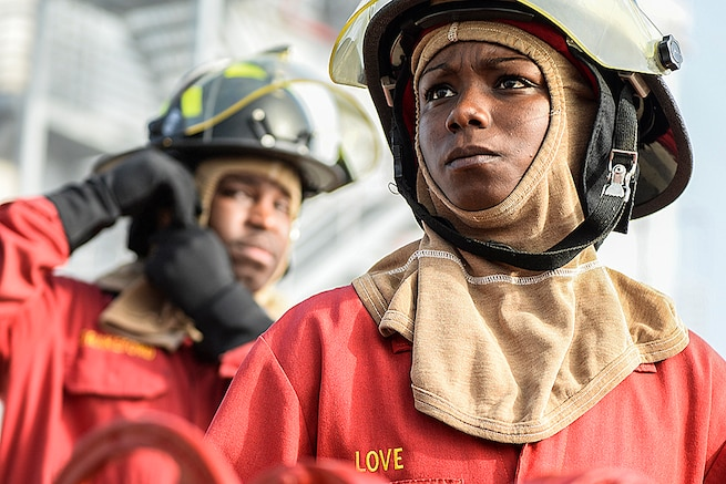 Navy Petty Officer 1st Class Biunca Love prepares to help lead a shipboard aircraft firefighting training event at the firefighting training facility at Naval Station Mayport, Fla., Feb. 2, 2016. Navy photo by Petty Officer 2nd Class Timothy Schumaker