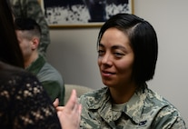 """Senior Airman Jazmin Gonzalaz-Araiza, 168th Wing vehicle management and analysis, gets the finishing color added to her fake injury Jan. 21, 2016, at Eielson Air Force Base, Alaska. Gonzalaz-Araiza and her wife both volunteered for the """"Thanks for Asking"""" campaign to show domestic violence can happen with same-sex couples. (U.S. Air Force photo by Airman 1st Class Cassandra Whitman/Released)"""