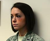 """1st Lt. Kelly Wheeler, 354th Medical Group nurse, don's a bruise to her eye Jan. 21, 2016, at Eielson Air Force Base, Alaska. Wheeler volunteered to adorn the bruise to raise awareness for domestic violence during the """"Thanks for Asking"""" campaign. (U.S. Air Force photo by Airman 1st Class Cassandra Whitman/Released)"""