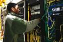 U.S. Air Force Airman 1st Class Angelo Dickerson, 354th Communications Squadron cyber transport systems technician, connects wires Jan. 27, 2016, at Eielson Air Force Base, Alaska. This wire system is where Dickerson physically connects users across the base to the network. (U.S. Air Force photo by Airman 1st Class Cassandra Whitman/Released)