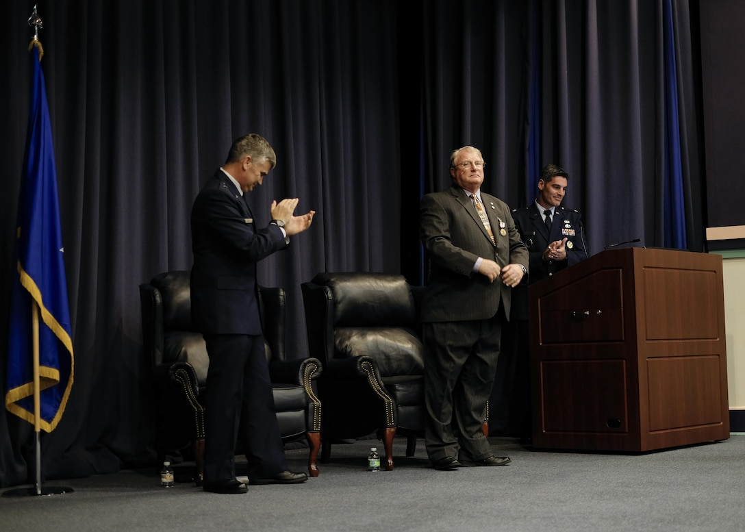 John Townsend, center, deputy division chief of special operations forces mobility with Air Force Special Operations Command, retired at the King Auditorium on Hurlburt Field, Fla., Jan. 22, 2016.Brig. Gen. Kirk Smith, director of strategic plans, programs and requirements at AFSOC, presided over the retirement ceremony.