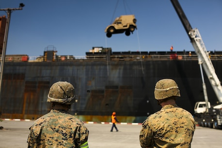 U.S. Marine Corps Cpl. Taylor White (left) and Lance Cpl. Scott Skith (right), both field artillery cannoneers, with 3rd Battalion, 12th Marines, wait for a vehicle to be offloaded from the USNS Maj. Stephen W. Pless, during exercise Cobra Gold 2016, on Sattahip Naval Base, Thailand, Jan. 28, 2016. Cobra Gold, in its 35th iteration, is an important element of the United States' and all other participating nations' regional military to military engagement efforts.)