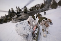 Marines with Alpha Company, 2nd Assault Amphibian Battalion, rush toward a CH-53E Super Stallion with a simulated avalanche victim at the Mountain Warfare Training Center in Bridgeport, Calif., Jan. 20, 2016. Marines across II Marine Expeditionary Force and 2d Marine Expeditionary Brigade took part in the training in preparation for Exercise Cold Response 16 in Norway this March. The exercise will feature military training including maritime, land and air operations that underscore NATO's ability to defend against any threat in any environment.