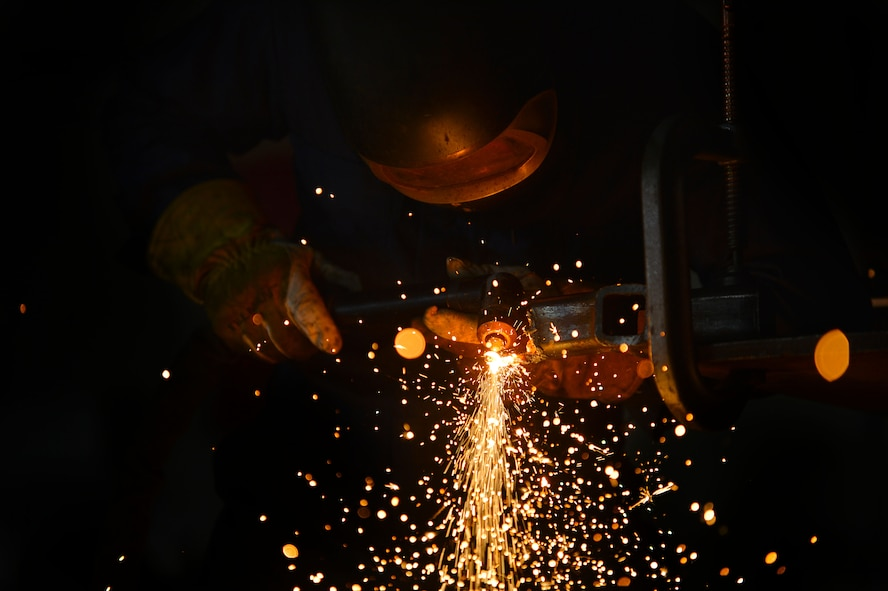 U.S. Air Force Senior Airman John Abbott, 20th Equipment Maintenance Squadron metal technology journeyman, uses a plasma cutter to weld a piece of metal at Shaw Air Force Base, S.C., Feb. 2, 2016. A plasma cutter can heat up to approximately 10,000 degrees Fahrenheit and is used to cut metal up to 10 inches thick. (U.S. Air Force photo by Senior Airman Michael Cossaboom)