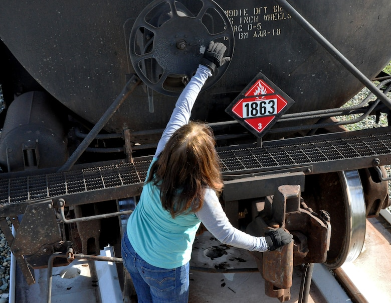 Sam Mertes, 9th Support Division locomotive engineer, disconnects a fuel car from the Beale train Jan. 20, 2016, at Beale Air Force Base, California. The train program primarily supports the U-2 Dragon Lady and processes jet fuel from Texas to ensure continuity of the flying mission. (U.S. Air Force photo by Staff Sgt. Jeffrey M.  Schultze)