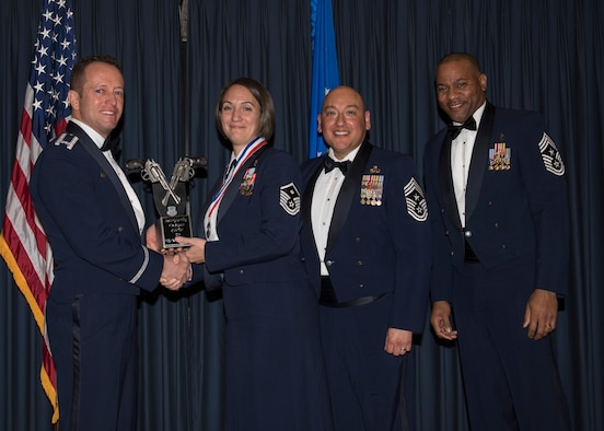 Master Sgt. Kathleen May accepts the 366th Fighter Wing First Sergeant of the Year award from 366th FW Commander Col. David Iverson, (left) 12th Air Force Command Chief Master Sgt. Jose Barraza and (right) 366th FW Command Chief Master Sgt. David Brown, during the Annual Awards Ceremony at Mountain Home AFB, Idaho, Jan. 29, 2016. May is a member of the 366th Operations Group at Mountain Home AFB. (U.S. Air Force photo by Senior Airman Jeremy L. Mosier/Released)
