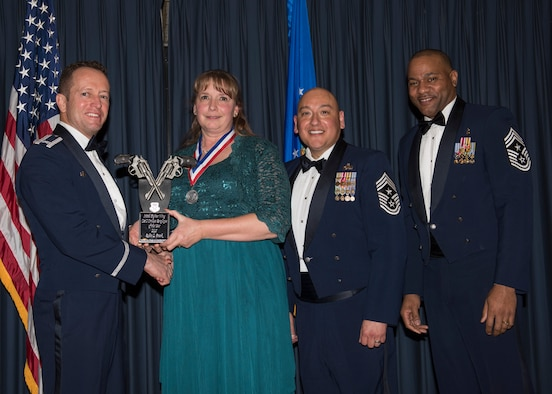 Robin Frank accepts the 366th Fighter Wing Category I Civilian Employee 