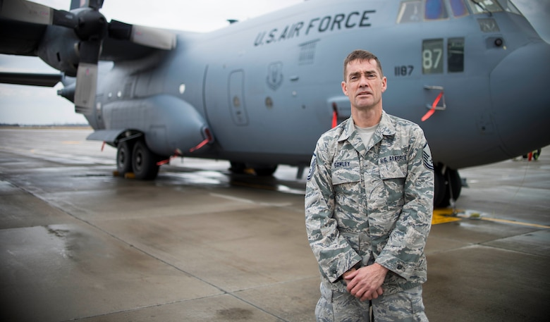 Master Sgt. Kenneth Dawley, crew chief, 914th Aircraft Maintenance Squadron, stands in front of a C-130H aircraft at Niagara Falls Air Reserve Station, January 9, 2016. Dawley has maintained these aircraft for 20 years. (U.S. Air Force photo by Tech. Sgt. Stephanie Sawyer)