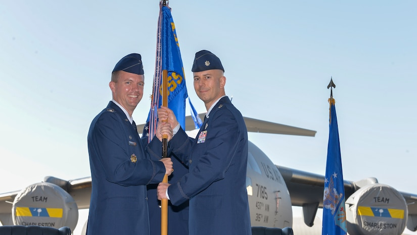 (From left to right) Colonel Scovill Currin, 437th Operations Group commander, passes command of the 437th Operations Support Squadron to Lt. Col. Todd Markwart at Joint Base Charleston – Air Base, S.C., on Feb. 2, 2016. The outgoing 437th OSS commander was Lt. Col. Terry Tyree Jr. (U.S. Air Force photo/ Airman 1st Class Thomas T. Charlton