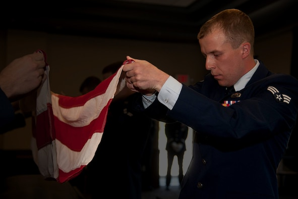 Senior Airman Sam Fogleman assumes the position of fold during his Honor Guard graduation ceremony, Sept. 11, 2015.  The two weeks of discipline training all comes together once you start performing real ceremonies. While performing funeral honors and colors presentations, the meaning of the whole assignment starts to come to light. The funeral honors, in particular, can make the most grizzled, jaded and hardened Airmen into relatively proud members of the greater military community. - Senior Airman Samuel Fogleman. (Courtesy Photo)