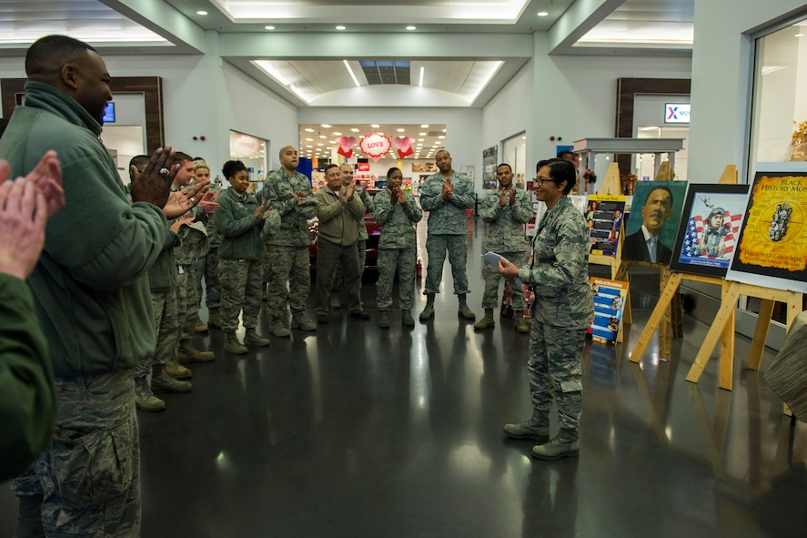 Airmen applause after U.S. Air Force Col. Patricia John, 52nd Medical Operations Squadron commander, gave her opening remarks for National African American History Month at The Exchange on Spangdahlem Air Base, Jan. 2, 2016. This is the 40th consecutive year that February has been NAAHM to remember the efforts and accomplishments of African Americans in the Unites States' history. (U.S. Air Force photo by Airman 1st Class Luke Kitterman/Released)