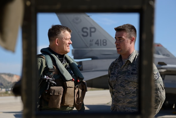 U.S. Air Forces in Europe and Air Forces Africa commander Gen. Frank Gorenc speaks with U.S. Air Force Staff Sgt. Daniel Walker, a crew chief assigned to the 480th Expeditionary Fighter Squadron, before departure during a flying training deployment at Souda Bay, Greece, Feb. 1. 2016.  Gorenc and Walker talked about how the FTD was progressing in its second week. (U.S. Air Force photo by Staff Sgt. Christopher Ruano/Released)
