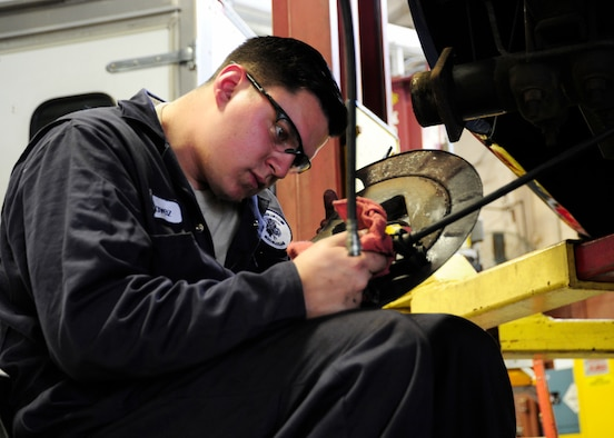 Staff Sgt. Christian Chavez, 325th Logistics Readiness Squadron vehicle maintenance supervisor, replaces an emergency brake cable on a government owned vehicle Feb. 2 at the vehicle maintenance shop. From trucks to buses, technicians like Chavez must have an extensive knowledge of the vehicles that come through the shop. (U.S. Air Force photo by Senior Airman Solomon Cook/Released)