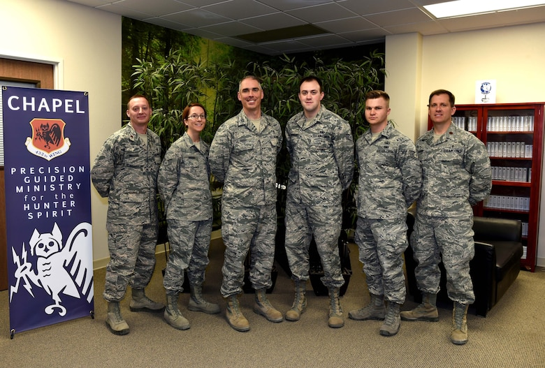 The Chaplain Corps at Creech Air Force Base, Nevada, poses for a photo Jan. 20, 2016, at the Creech Airman Ministry Center.  The team is dedicated to taking care of the Hunter family by bringing precision guided ministry to the mission. Through unit visitation and meeting with Airmen for spiritual and religious counseling, Chaplains contribute to the success of the mission. (U.S. Air Force photo by Airman 1st Class Kristan Campbell/Released)