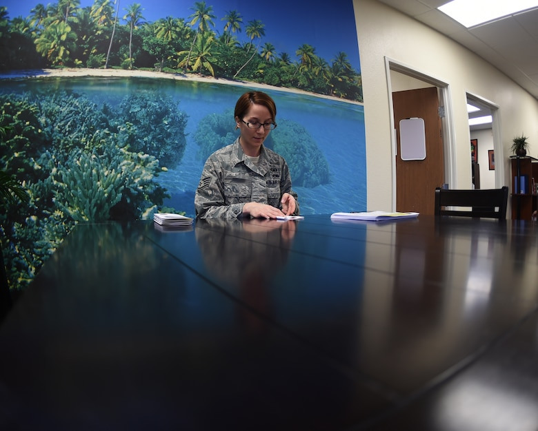 Staff Sgt. Sarah, 452nd Air Mobility Wing chaplain assistant, prepares for a meeting with the chaplain corps Jan. 20, 2016, at Creech Air Force Base, Nevada. Sarah and Chaplain (Maj.) Cameron, 47th Flying Training Wing Individual Mobilization Augmentee, are new additions to the Creech team. Adding to the manning at the Airman Ministry Center has increased chaplain availability for Airmen seeking spiritual and religious guidance. (U.S. Air Force Photo by Airman 1st Class Kristan Campbell/ released)