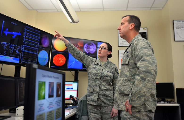 U.S. Air Force Senior Airman Amanda Otto, assigned to the 2nd Weather Squadron, discusses space weather with U.S. Air Force Col. Jay R. Bickley, 12th Air Force (Air Forces Southern) vice commander, as part of his tour of the 557th Weather Wing, Offutt Air Force Base, Neb., Jan. 25, 2016.  Bickley spent the day meeting  Airmen and learning about their daily operations.  (U.S. Air Force photo by Josh Plueger/released)