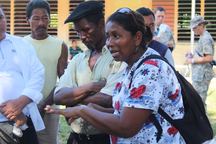 Candida Derek Jackson, Nueva Jerusalén Municipal Health Director, Gracias a Dios, where Nueva Jerusalén is located, speaks to the people in native Miskito language, to explain the kinds of services provided and the procedures to follow, during a Medical Readiness Training Exercise, January 28, 2016. This joint effort between U.S. service members and Honduran health representatives will aid communities in the remote area that is lacking proper health care facilities and medications. (U.S. Army photo by Maria Pinel/Released)
