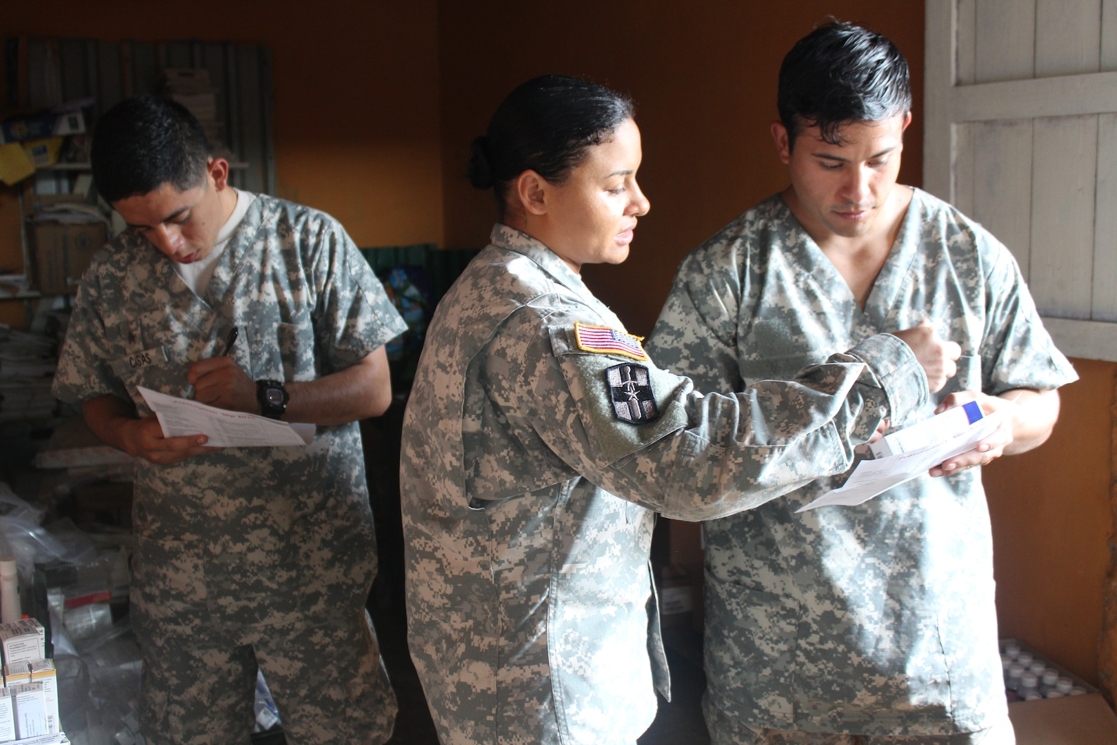 Service members from Joint Task Force-Bravo Medical Element assigned to pharmacy duties, read prescriptions before dispatching to the local population during a Medical Readiness Training Exercise in Nueva Jerusalén, Gracias a Dios Department, Honduras, Jan. 28, 2016. This is the final station that patients visit after receiving a basic health class, going through a screening process, and after seeing a medical provider. (U.S. Army photo by Maria Pinel/Released)
