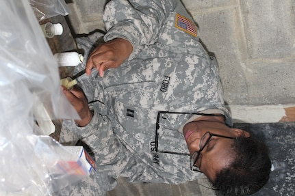 U.S. Army Captain Marshon Ford, Joint Task Force-Bravo Medical Element nurse, prepares de-worming medication for children during a Medical Readiness Training Exercise in Nueva Jerusalén, Gracias a Dios Department, Honduras, Jan. 28, 2016. The medication is one of many services the MEDRETE provides to patients, including, a basic health class from Honduran military representatives and dental services, to name a few. (U.S. Army photo by Maria Pinel/Released)