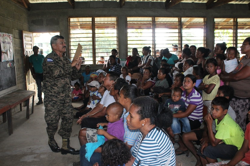 Sgt. Luis Alons211099o Aleman, with the Honduran Army  6th Infantry Battalion, gives patients a preventive health class before visiting the medical care providers during a Medical Readiness Training Exercise in Nueva Jerusalén, Gracias a Dios Department, Honduras, Jan. 28, 2016. This class is intended to help prevent many of the common illnesses in the area, which can be prevented through basic hygiene measures. (U.S. Army photo by Maria Pinel/Released)