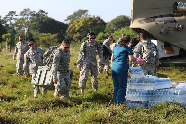 Service members from Joint Task Force-Bravo's Medical Element unload medical supplies for a Medical Readiness Training Exercise in Nueva Jerusalén, Gracias a Dios Department, Honduras, Jan. 28, 2016. These partnerships allow service members to engage with the local community, while supporting local health organizations in remote areas of the host nation in need of medical services.   (U.S. Army photo by Maria Pinel/Released)