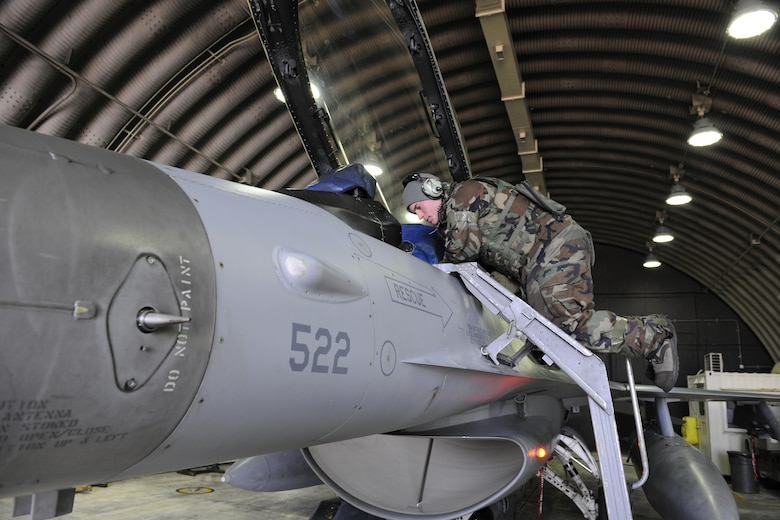 Senior Airman Kollin Bell, 35th Aircraft Maintenance Squadron crew chief, conducts a pre-flight lights inspection to ensure all critical lights are working on an F-16 Fighting Falcon during Beverly Pack 16-2 at Kunsan Air Base, Republic of Korea, Feb. 3, 2015. The 8th Maintenance Group's over 1,000 Airmen have worked around-the-clock amid temperatures in the teens to ensure all the wing's  F-16s are ready to fly safely. (U.S. Air Force photo by Senior Airman Dustin King/Released)