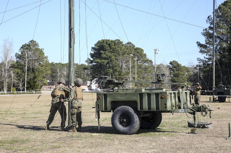 Marines with Headquarters Company, Combat Logistics Regiment 25, conduct a maintenance check on an antenna during a command post exercise at Camp Lejeune, N.C., Feb. 2, 2016. The CPX was held as a pre-cursor to an II Marine Expeditionary Force-wide CPX. (U.S. Marine Corps photo by Cpl. Paul S. Martinez/Released)