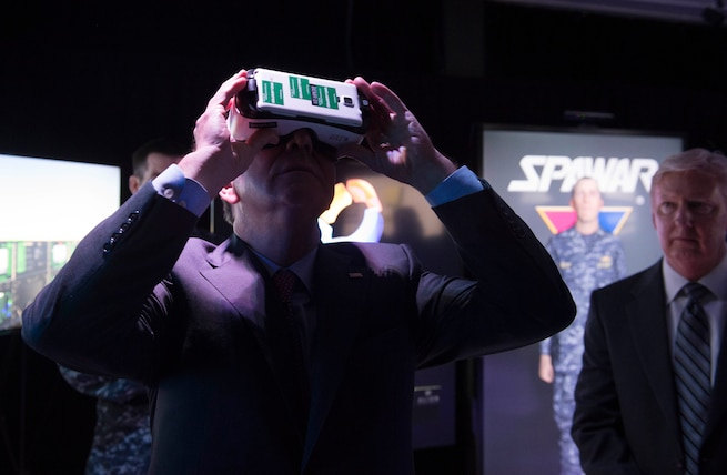 Defense Secretary Ash Carter uses a virtual reality display at the Space and Naval Warfare Systems Command in San Diego, Feb. 3, 2016. DoD photo by Navy Petty Officer 1st Class Tim D. Godbee